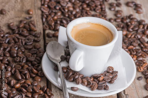 Wall Murals Cafe Espresso cup with coffee beans texture