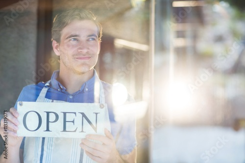 Smiling chef holding open sign Poster