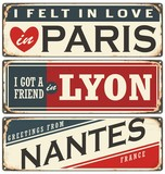 Retro tin sign collection with French cities