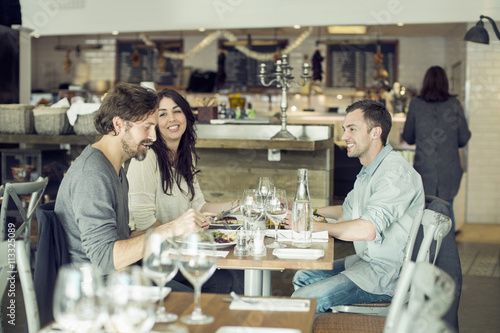 People eating meal at restaurant