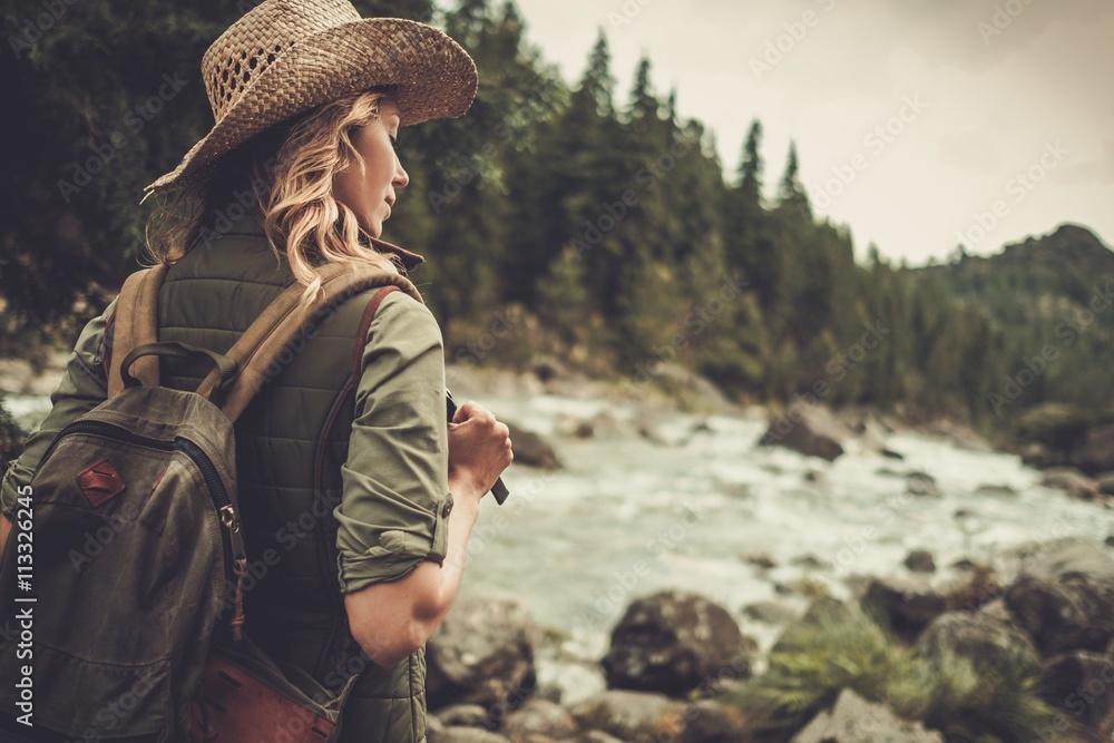 Fototapety, obrazy: Beautiful woman hiker enjoying amazing landscapes near wild mountain river.