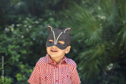 Little boy wearing animal mask