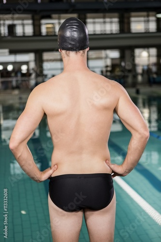 Rear view of swimmer standing by the pool Canvas Print