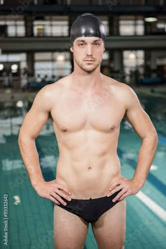 Portrait of swimmer standing by the pool Canvas Print