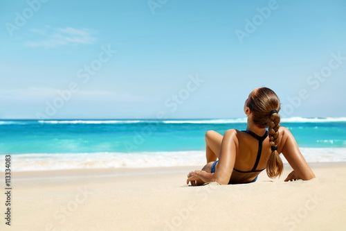 Photo  Woman On Beach In Summer. Sexy Happy Female Model Tanning