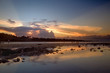 Sunset scene with mirror reflection on a tropical sea beach. in Bali.