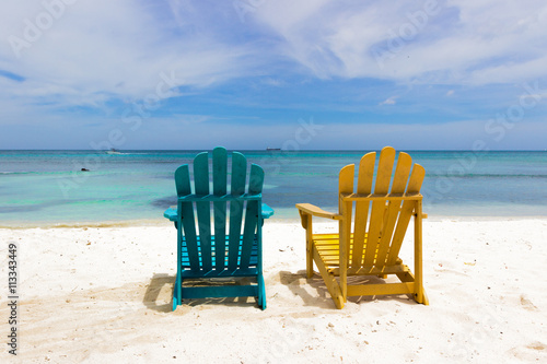 Foto op Plexiglas Caraïben colorful chairs on caribbean coast