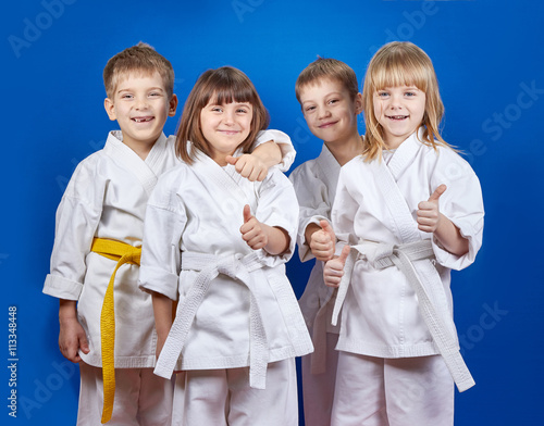 Garden Poster Martial arts Children in karategi are showing finger super