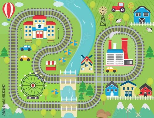 Zdjęcie XXL Urocza tor wyścigowy z pejzażem miejskim do zabawy dla dzieci i rozrywki. Słoneczny krajobraz miasta z góry, farmy, fabryki, budynki, rośliny i niekończące się tory kolejowe.