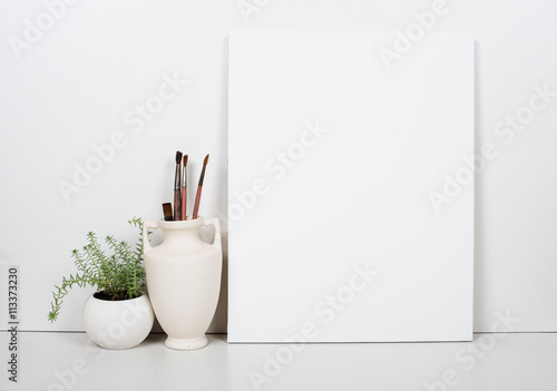 Fotografía Empty blank canvas on a white background, home interior decor