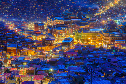 Wall Murals Temple Top view night scene at Larung gar (Buddhist Academy) in Sichuan, China