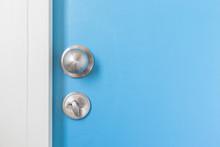 Metal Silver Doorknob On Wooden Door