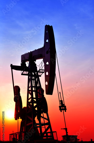 Fototapeta Oil Pump on orange sunset obraz na płótnie