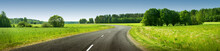 Asphalt Road Panorama In Countryside On Sunny Summer Day