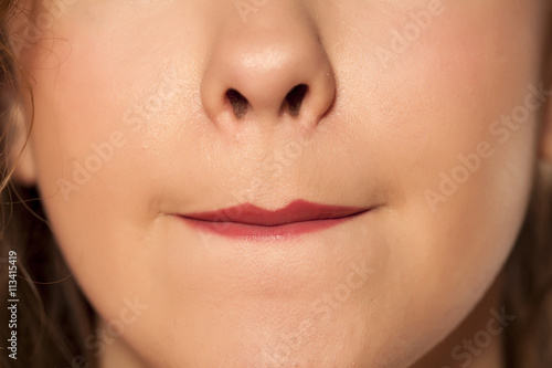 Photo women allocated lipstick with her lips