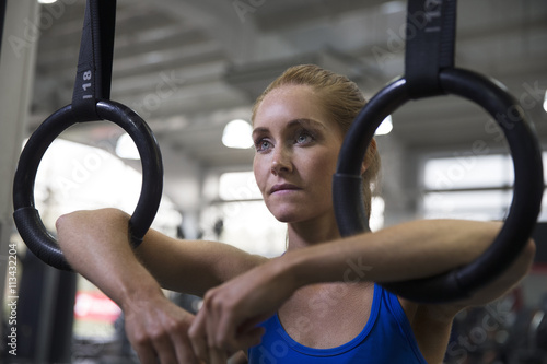 Young Woman Using Fitness Equipment In Gym Poster