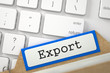 Export. Blue Card File Concept on Background of Modern Keyboard. Archive Concept. Blue Index Card with Export Overlies White PC Keypad. Archive Concept. Closeup View. Blurred Image. 3D Rendering.