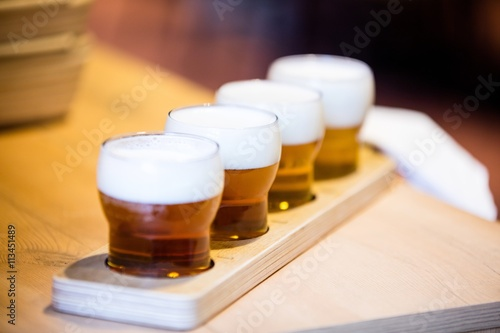 Close-up of beer glasses on the counter Canvas