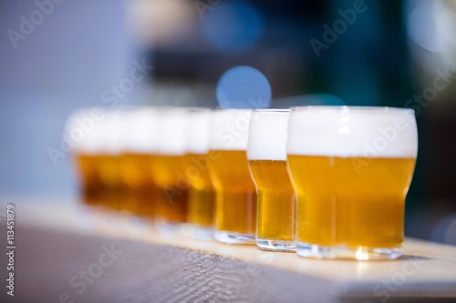 Close-up of beer glasses on the counter Poster