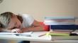Schoolgirl learns lessons, cute girl sleeping on books