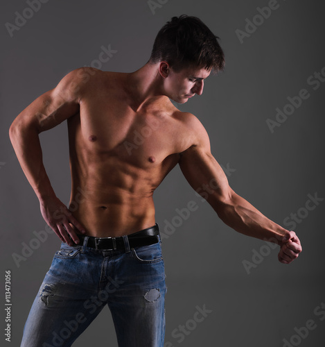 003e9e25 Shirtless muscular guy from back in blue jeans - Buy this stock ...