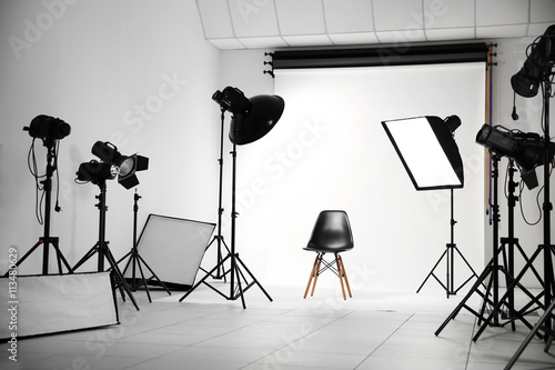 Valokuva  Empty photo studio with lighting equipment