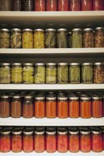 Pickle Jars Arranged On Shelves At Market