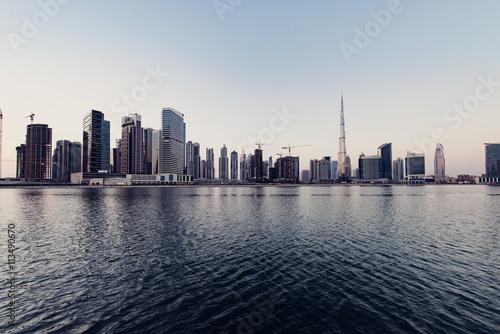 Cityscape and Dubai creek against clear sky Poster
