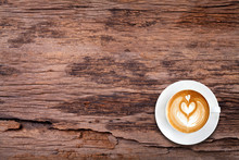 Top View Latte Art Coffee On Wood Texture Background