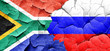 canvas print picture - South africa flag with Russia flag on a grunge cracked wall