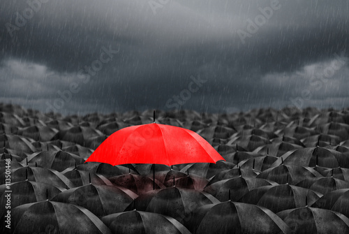 Obraz red umbrella in mass of black umbrellas - fototapety do salonu