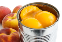 Detail Of Open Can Of Peach Halves In Syrup On White Background