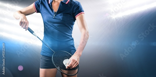 Obrazy Badminton   badminton-player-holding-a-racquet-ready-to-serve-against-spotlights