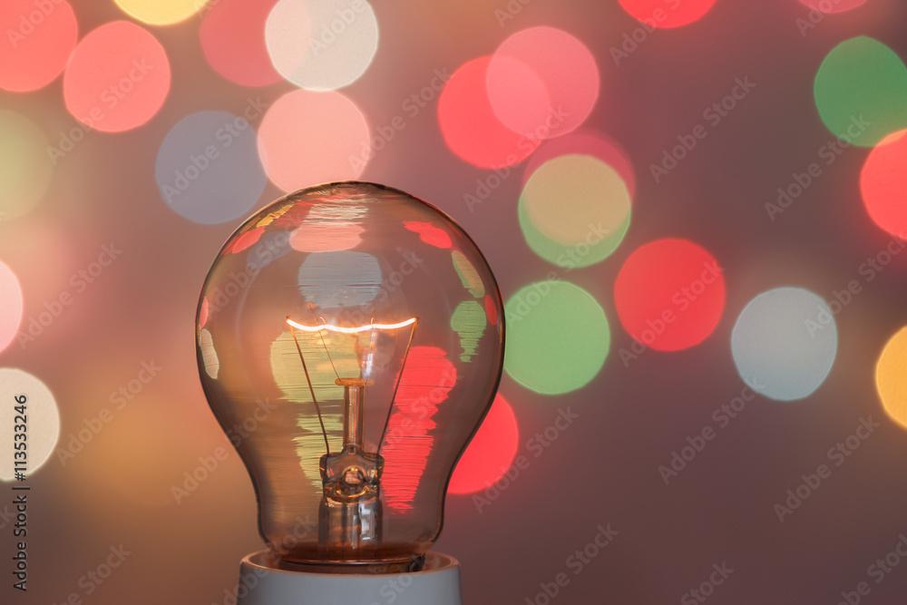 Fototapety, obrazy: Concept light bulb with a light bokeh background design
