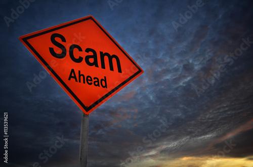 Fotografia, Obraz Scam ahead warning road sign