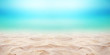 Close up sand with blurred sea sky background, summer day, copy space or for product. Panorama.