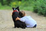 Fototapeta Zwierzęta - child and dog