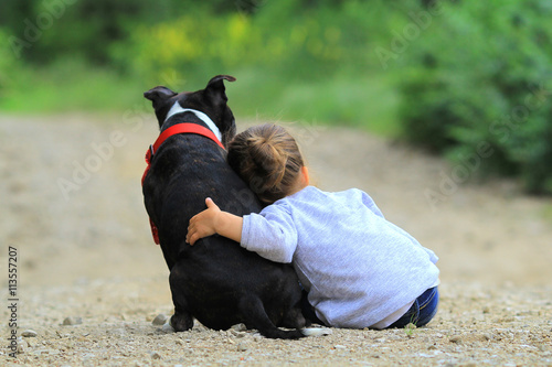 fototapeta na szkło child and dog