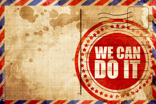 Photo  we can do it, red grunge stamp on an airmail background