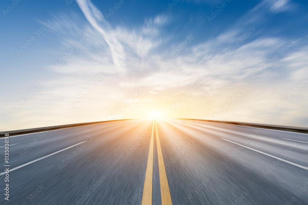 Fototapeta Fuzzy motion asphalt highway at sunset scene