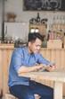 man using digital tablet in cafe