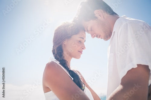 Fototapeta Happy couple embracing on the beach