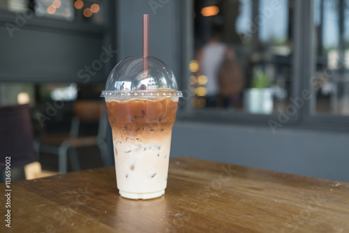 Foto op Aluminium Milkshake Ice coffee on a wooden table
