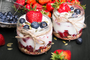 delicious dessert - yogurt with strawberries and blueberries