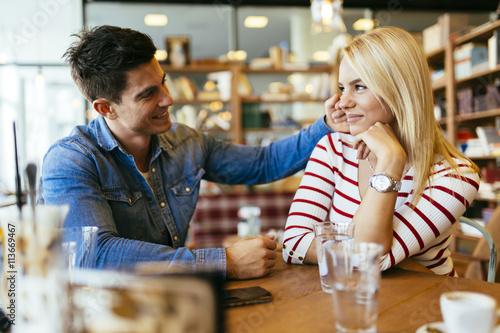 Fotografie, Tablou Beautiful couple in love flirting in cafe