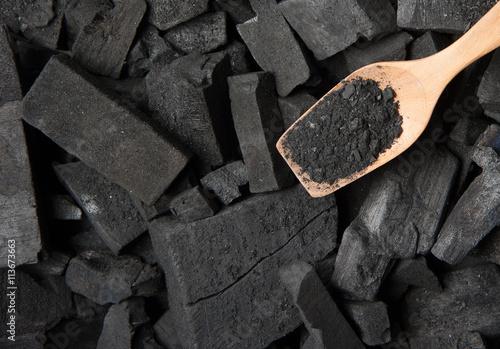 Photo Black particles charcoal