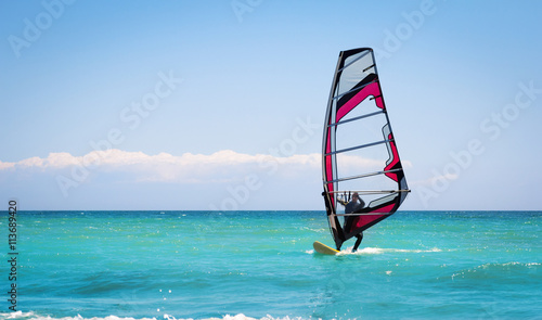 obraz PCV Windsurfing sails on the blue sea