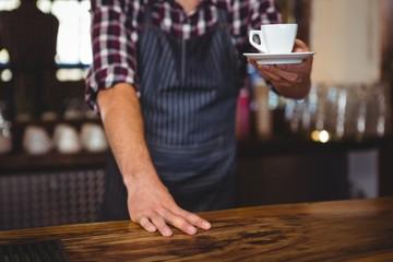 Waiter handing over a coffee