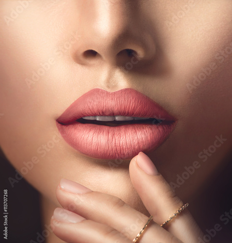 Fotografiet Perfect woman's sensual lips with fashion natural beige matte lipstick makeup