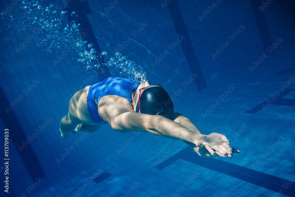 Swimmer woman underwater Canvas Print